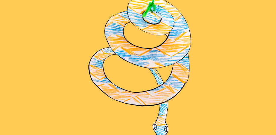 Spiral snake paper craft with crayon patterns against yellow background