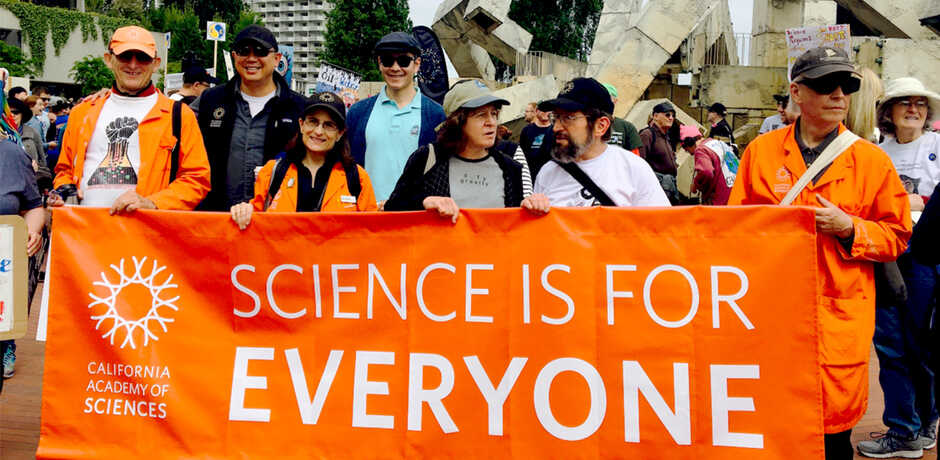 """March for Science banner says """"Science is for Everyone"""" held by Academy staff"""