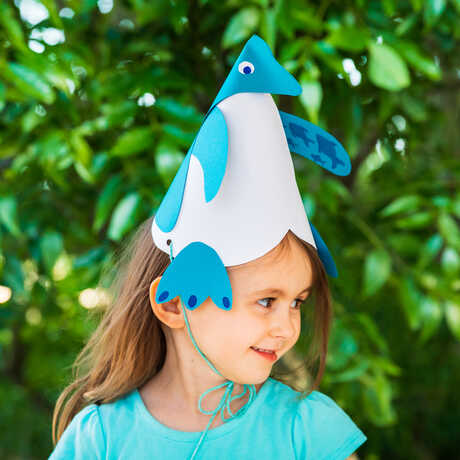 Girl wearing penguin party hat