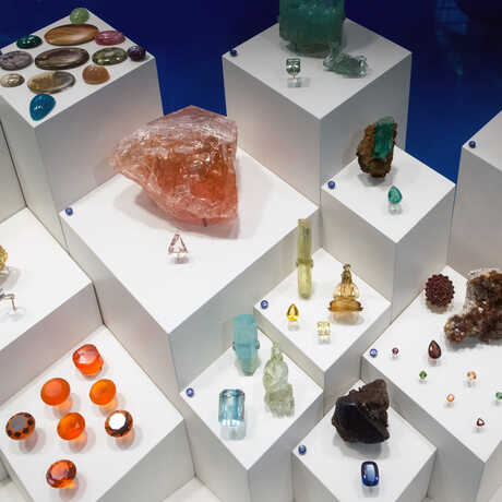 Assorted gems and minerals on pedestals in the exhibit