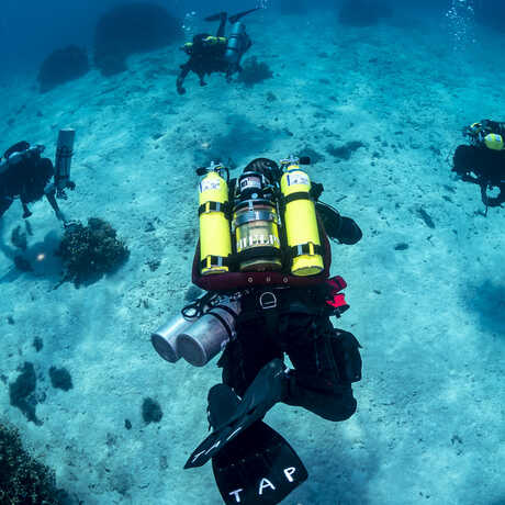 A group of scuba divers underwater in the Marshall Islands