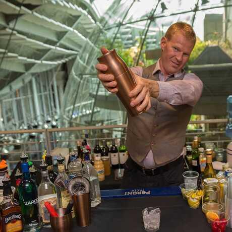 Bartender at NightLife uses a cocktail shaker