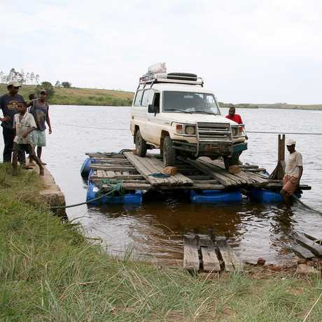 Fisher's expedition jeep floats on a homemade raft