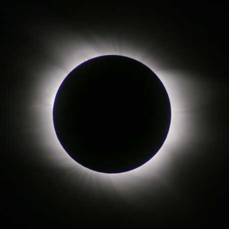 Dramatic image of the sun blocked by Moon shadow during solar eclipse