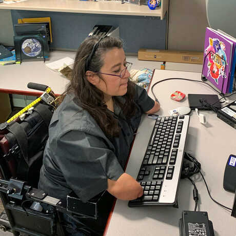 Dana Bolles working at a desk
