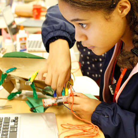 A girl programs an electronic puppet in an Academy after-school program