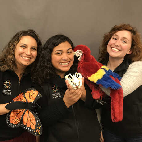 Academy educators holding puppets used in Distance Learning programs.