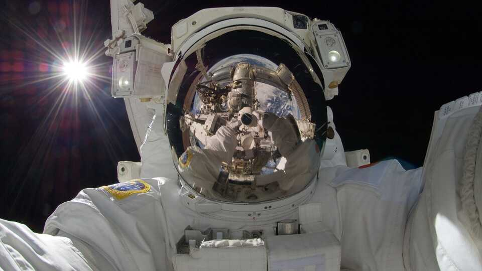 Astronaut selfie in space with reflective helmet visor
