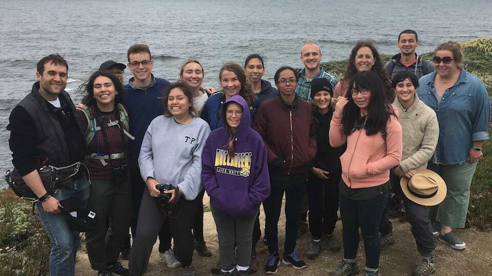 Students and instructors on a cliff overlooking the Pacific Ocean